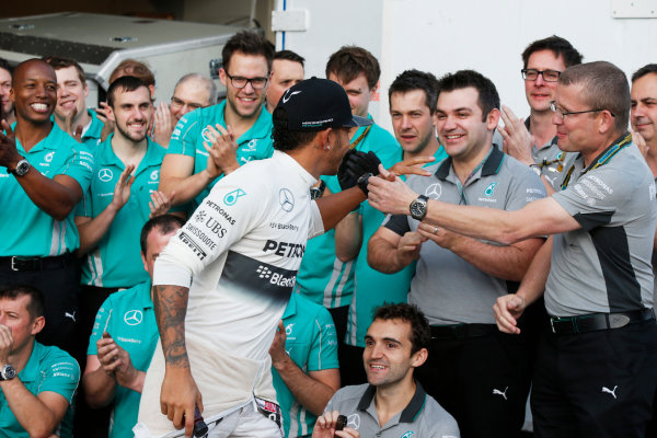 Circuit of the Americas, Austin, Texas, United States of America. Sunday 2 November 2014. Lewis Hamilton, Mercedes AMG, 1st Position, celebrates with his team. World Copyright: Charles Coates/LAT Photographic. ref: Digital Image _N7T5611