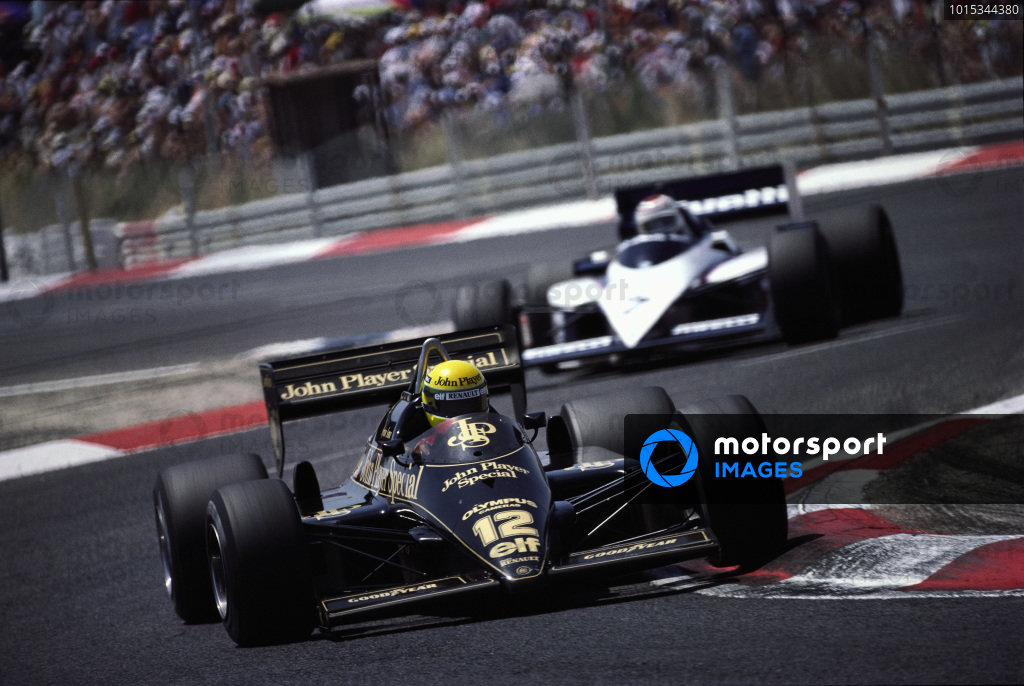 Ayrton Senna, Lotus 97T Renault, leads Nelson Piquet, Brabham BT54 BMW.