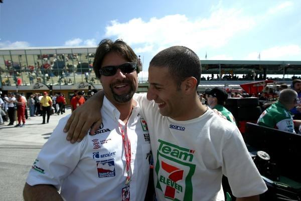 Andretti Green team owner Michael Andretti (USA), left, and Tony Kanaan (BRA), enjoy a laugh before qualifying for the Toyota Indy 300.