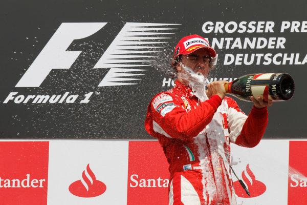 Hockenheimring, Hockenheim, Germany 25th July 2010 Fernando Alonso, Ferrari F10, 1st position, sprays the champagne on the podium. Portrait. Podium.  World Copyright: Andrew Ferraro/LAT Photographic ref: Digital Image _Q0C4575