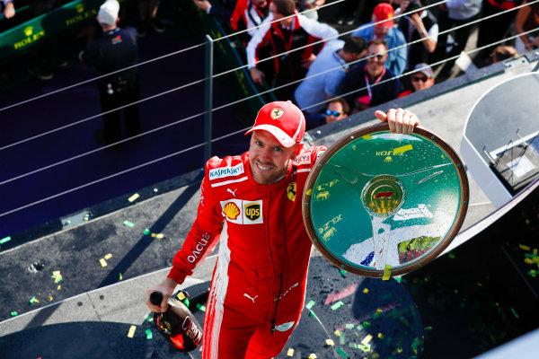 Sebastian Vettel, Ferrari, celebrates victory on the podium.