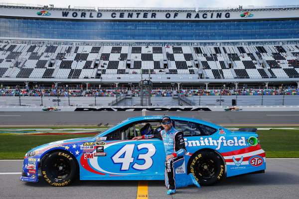 13-21 February, 2016, Daytona Beach, Florida USA   Aric Almirola, driver of the #43 Smithfield Ford, poses with his car after qualifying for the NASCAR Sprint Cup Series Daytona 500 at Daytona International Speedway on February 14, 2016 in Daytona Beach, Florida.   LAT Photo USA via NASCAR via Getty Images