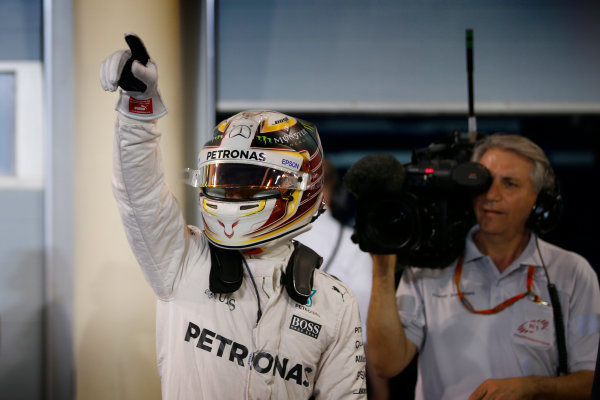 Bahrain International Circuit, Sakhir, Bahrain. Saturday 2 April 2016. Lewis Hamilton, Mercedes AMG celebrates after taking Pole Position. World Copyright: Glenn Dunbar/LAT Photographic ref: Digital Image _W2Q5654