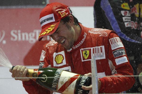Marina Bay Circuit, Singapore. 26th September 2010. Fernando Alonso, Ferrari F10, 1st position, sprays the victory Champagne. Portrait. Podium.  World Copyright: Andrew Ferraro/LAT Photographic ref: Digital Image _Q0C6257