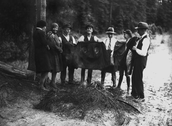 Nurburgring, Germany. 19th July 1931. Some fans light a fire to dry their clothes due to the heavy rainfall during the race, portrait.  World Copyright: LAT Photographic. Ref:  Autocar Glass Plate B6813