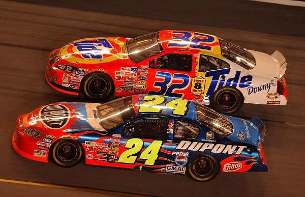 Second placed Jeff Gordon (USA) DuPont Chevrolet dives underneath Ricky Craven (USA) Tide Pontiac who finished tenth. 
