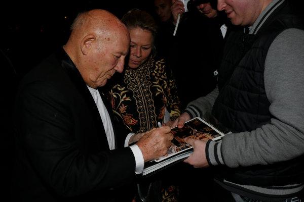 2014 Autosport Awards. Grosvenor House Hotel, Park Lane, London. Sunday 7 December 2014. Sir Stirling Moss signs autographs outside the Grosvenor House Hotel. World Copyright: Zak Mauger/LAT Photographic. ref: Digital Image _L0U9176