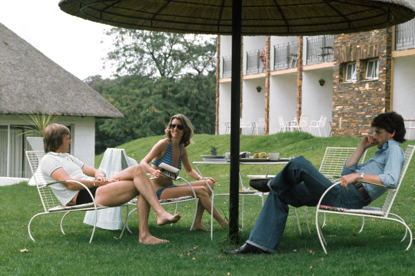 Kyalami, South Africa. 6 March 1976. Ronnie Peterson (March 761-Ford), retired, relaxes with his wife Barbro and Tom Pryce (Shadow DN5B-Ford). 7th position, before the race, portrait.  World Copyright: LAT Photographic. Ref:  76SA25