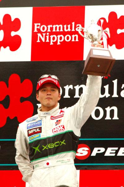 2002 Formula Nippon ChampionshipFuji, Japan. 07th April 2002,Satoshi Motoyama (Xbox Impul), podium.World Copyright: Yasushi Ishihara/LAT Photographicref: 8mb Digital Image Only