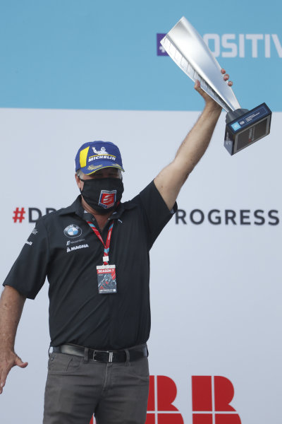 Michael Andretti, Team Owner, BMW I Andretti Motorsports, lifts the teams trophy on the podium