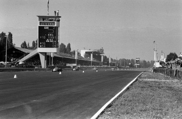 Karl Kling, Mercedes W196, follows Piero Taruffi, Mercedes W196, along the pit straight.