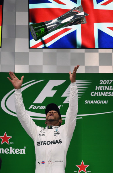 Race winner Lewis Hamilton (GBR) Mercedes AMG F1 celebrates on the podium with the trophy at Formula One World Championship, Rd2, Chinese Grand Prix, Race, Shanghai, China, Sunday 9 April 2017. BEST IMAGE