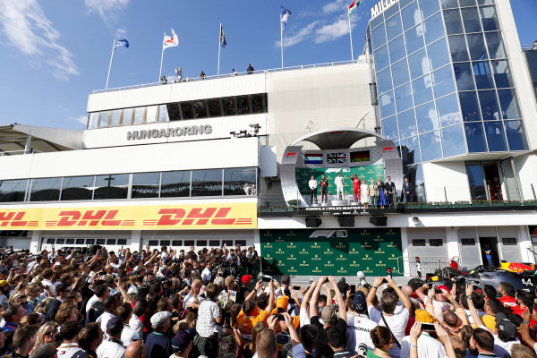 James Vowles, Motorsport Strategy Director, Mercedes AMG F1, Max Verstappen, Red Bull Racing, Race winner Lewis Hamilton, Mercedes AMG F1 and Sebastian Vettel, Ferrari celebrate on the podium over the top of Parc Ferme