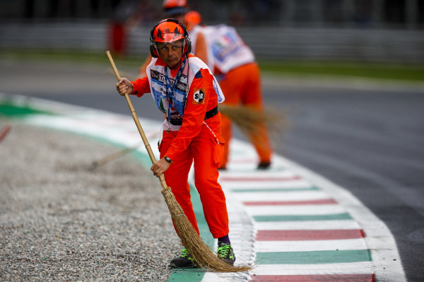 Marshal sweeps gravel during Red Flag
