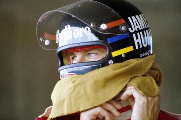 James Hunt makes an adjustment to his helmet.