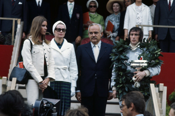 Winner Jackie Stewart on the podium with Prince Albert and Princess Grace and wife Helen.
