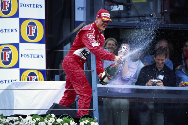 Michael Schumacher, 1st position, sprays champagne on the podium.