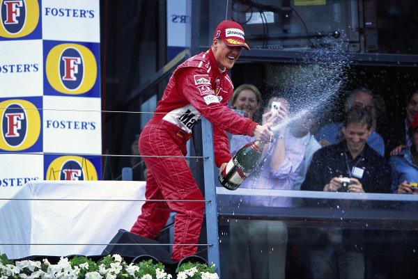 Michael Schumacher, 1st position, sprays champagne on the podium.