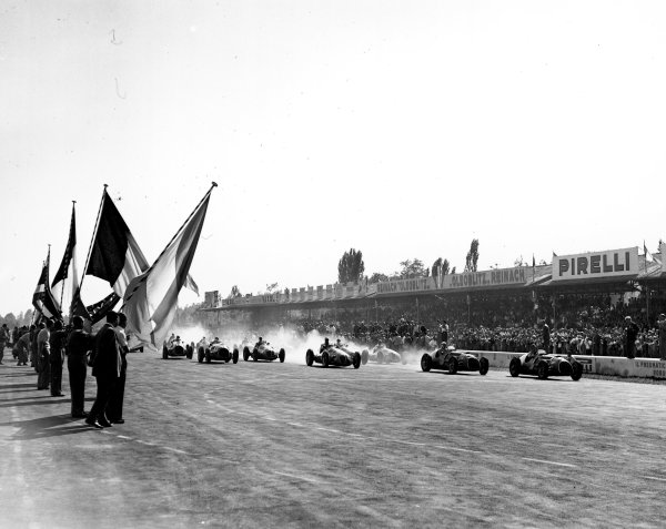 1949 Italian Grand Prix.Monza, Italy. 9-11 September 1949.Alberto Ascari and Luigi Villoresi (both Ferrari 125's) lead away at the start. Ascari finished in 1st position.Ref-C25314.A Race Through Time exhibition number 74.World Copyright: LAT Photographic