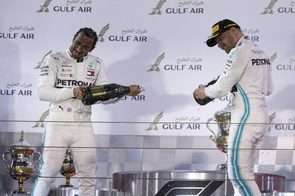 Lewis Hamilton, Mercedes AMG F1, and Valtteri Bottas, Mercedes AMG F1, spray champagne on the podium