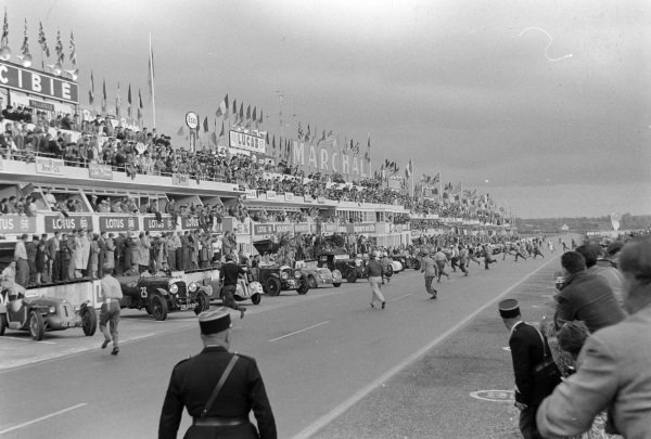 Drivers run to their cars in the Pre-1939 Retrospective of Le Mans demonstration race.