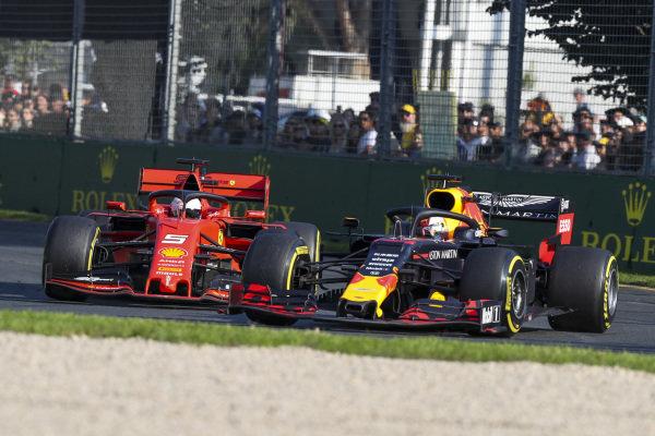 Max Verstappen, Red Bull Racing RB15 overtakes Sebastian Vettel, Ferrari SF90