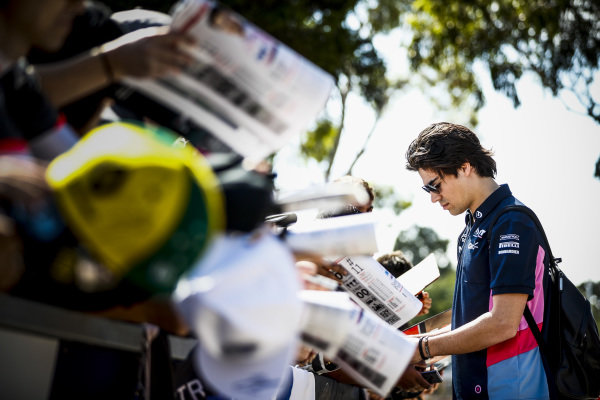 Lance Stroll, Racing Point signs an autograph for a fan.