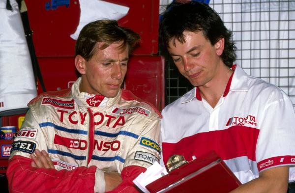 Johnny Dumfries (GBR) TOM'S Toyota talks with his engineer.