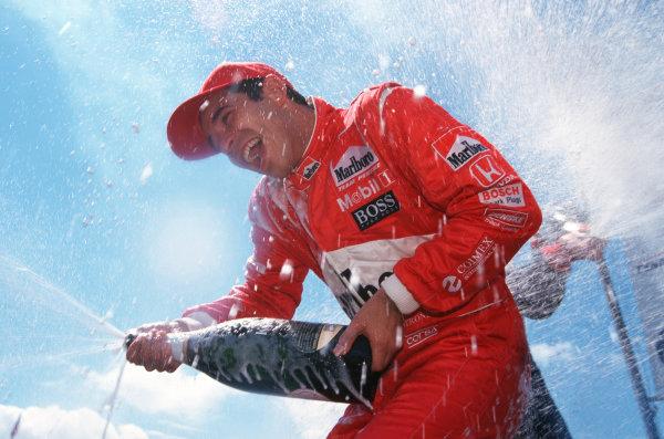 2000 CART Detroit GP, June 18, 2000, Detroit, MI, USAHelio Castroneves celebrates. 20 MB FILE!-2000, Michael L. Levitt, USALAT PHOTOGRAPHIC