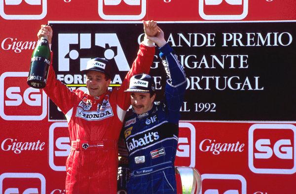 (L to R): Gerhard Berger (AUT) Ferrari and Nigel Mansell (GBR) Williams celebrate on the podium. Formula One World Championship, Rd14, Portugese Grand Prix, Estoril, Portugal, 27 September 1992.