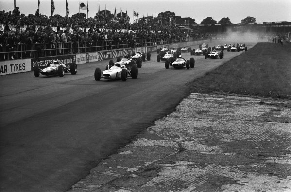 Silverstone, Great Britain. 10 July 1965.Jim Clark, Lotus 33-Climax, 1st position, and Richie Ginther, Honda RA272, retired, lead at the start, action.World Copyright: LAT PhotographicRef: L65/334/27A-28