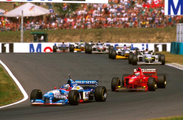 Hungaroring, Hungary.8-10 August 1997.Gerhard Berger (Benetton B197 Renault) 8th position followed by Eddie Irvine (Ferrari F310B).Ref-97 HUN 26.World  Copyright - LAT Photographic