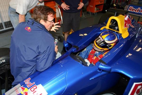 Colin Fleming (USA) gets into an F3000 car.Red Bull US Driver Search, Estoril, Portugal, 12-13 October 2004.DIGITAL IMAGE