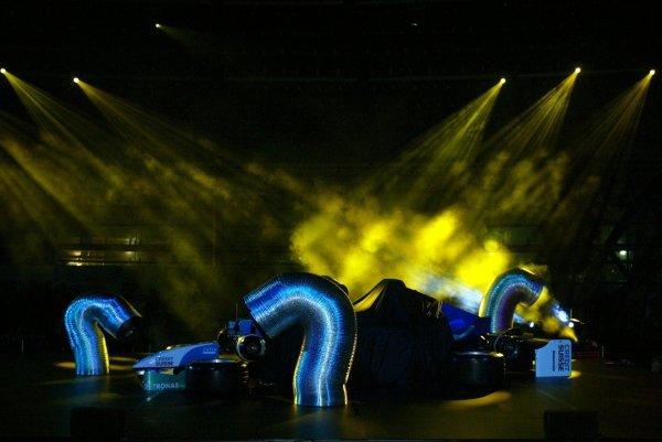 Dancing silver tubes unveil the new car.Sauber C23 Launch, Red Bull Hangar 7, Salzburg, Austria, 12 January 2004.DIGITAL IMAGE