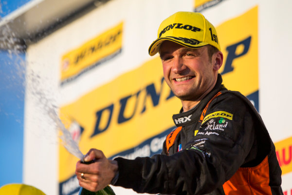 2015 British Touring Car Championship, Silverstone, Northamptonshire, England. 26th - 27th September 2015. Colin Turkington (GBR) Team BMR Volkswagen Passat CC, 1st position, on the podium. World Copyright: Zak Mauger/LAT Photographic. ref: Digital Image _L0U4866