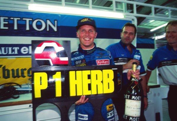Johnny Herbert (GBR) Benetton celebrates his win in the pits. Formula One World Championship, British Grand Prix, Silverstone, England, 16 July 1995.