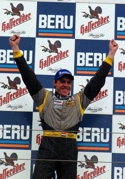Race 2 winner Ross Zwolsman (NED) ma-con Racing on the podium.German Formula Renault Championship, Rd6, Races 11 and 12, Nurburgring, Germany. 22 September 2002.DIGITAL IMAGE