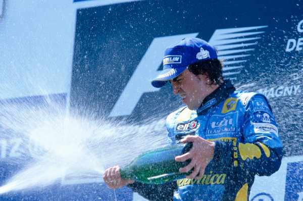 2005 French Grand Prix. Magny-Cours, France. 1st - 3rd July 2005 Fernando Alonso, Renault R25 celebrates on his victory on the podium. World Copyright: Peter Spinney/LAT Photographic Ref: 35mm Image A03