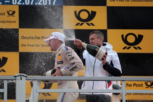 2017 DTM Round 4 Norisring, Nuremburg, Germany Sunday 2 July 2017. Podium: Maxime Martin, BMW Team RBM, BMW M4 DTM and Bart Mampaey, Team principal BMW Team RBM World Copyright: Alexander Trienitz/LAT Images ref: Digital Image 2017-DTM-R3-NOR-AT1-3859