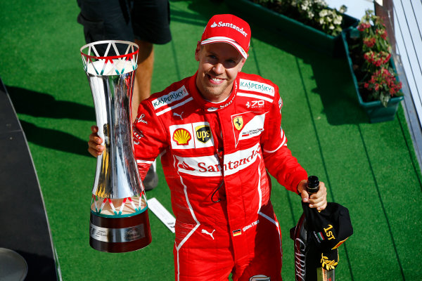 Hungaroring, Budapest, Hungary.  Sunday 30 July 2017. Sebastian Vettel, Ferrari, 1st Position, celebrates on the podium with his trophy. World Copyright: Andrew Hone/LAT Images  ref: Digital Image _ONZ1203