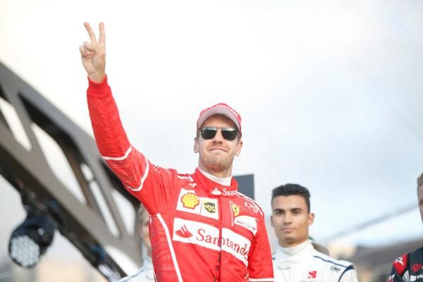 London, United Kingdom.  Wednesday 12 July 2017. Sebastian Vettel, Ferrari, and Pascal Wehrlein, Sauber. World Copyright: Joe Portlock/LAT Images  ref: Digital Image _L5R8728