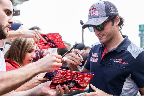 Circuit de Catalunya, Barcelona, Spain. Thursday 11 May 2017. Carlos Sainz Jr, Toro Rosso, signs autographs for his fans. World Copyright: Charles Coates/LAT Images ref: Digital Image GT2R3920