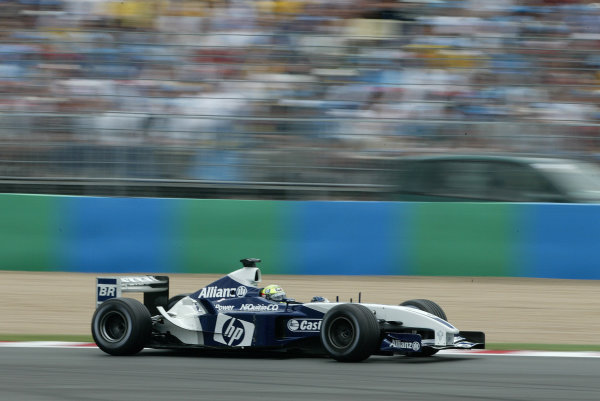 2003 French Grand Prix - Sunday Race,Magny Cours, France. 06th July 2003 Race winner Ralf Schumacher, BMW Williams FW25, action.World Copyright: Steve Etherington/LAT Photographic ref: Digital Image Only