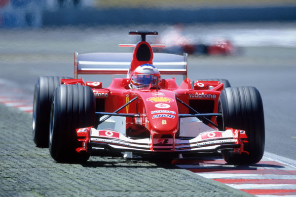 2004 French Grand PrixMagny-Cours, France. 2nd - 4th JulyRubens Barrichello, Ferrari F2004 exits the last corner. Action. World Copyright: LAT PhotographicRef:35mm Image A08