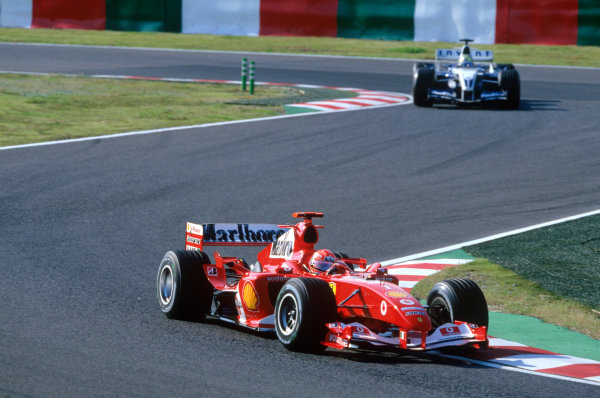 2004 Japanese Grand Prix.Suzuka , Japan 8th - 10th October 2004Michael Schumacher, Ferrari F2004 leads Ralf Schumacher, WilliamsF1 BMW FW26. Action. World Copyright:Charles Coates/LAT Photographic ref: 35mm Image: A15