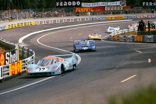 Le Mans, France. 12th - 13th June 1971. Jo Siffert/Derek Bell (Porsche 917L), retired, leads Mark Donohue/David Hobbs (Ferrari 512M), retired, action.  World Copyright: LAT Photographic. Ref: 71LM45