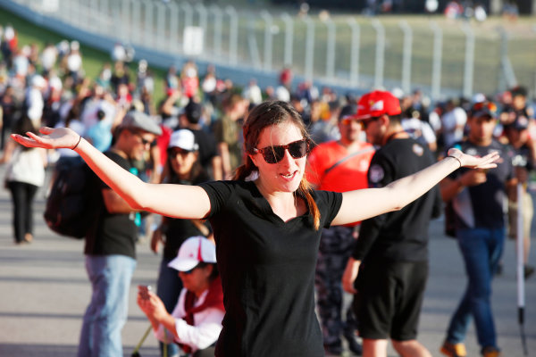 Circuit of the Americas, Austin, Texas, United States of America. Sunday 2 November 2014. Fans celebrate after the race. World Copyright: Charles Coates/LAT Photographic. ref: Digital Image _N7T5559