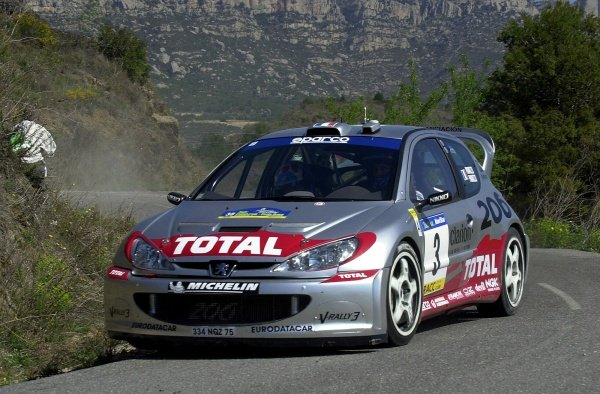 Tour de Corse rally winner Gilles Panizzi (FRA) and co-driver Herve Panizzi (FRA) Peugeot 206 WRC on Stage 3. Tarmac specialist Panizzi dominated by winning every stage of leg 1.Rally of Catalunya, Rd4, Spain. Day One. 22 March 2002.DIGITAL IMAGE