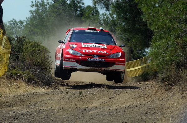 Richard Burns (GBR) / Robert Reid (GBR) Peugeot 206 WRC.World Rally Championship, Rd7, Cyprus Rally, Shakedown, 19 June 2003.DIGITAL IMAGE