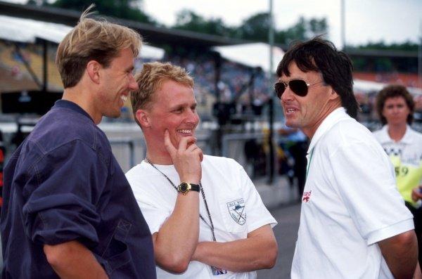 (L to R): Race retiree JJ Lehto (FIN) Sauber and tenth placed Johnny Herbert (GBR) Lotus talk with Adrian Reynard (GBR) Reynard Racing Cars Owner.  German Grand Prix, Rd 10, Hockenheim, Germany, 25 July 1993.